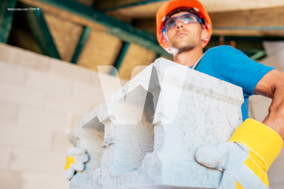 Worker with Concrete Block