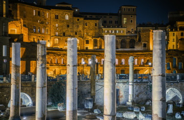 Coloseum And Ruins Of Marble Columns In Rome.