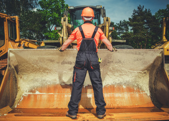 Heavy Equipment Operator Hooks Up Specialized Bucket To Machine.