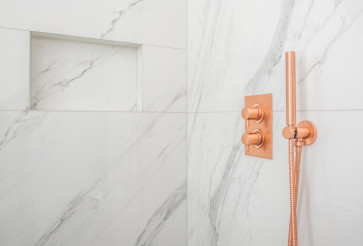 Close Up Of Upscale Shower Cabin With Copper Faucet.