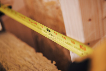 Close Up Of Tape Measure Showing Distance In Inches.