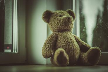 Teddy Bear Toy Placed Next to Window