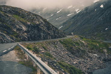 View Of Winding  Country Road Through Norwegian Mountain Hills.