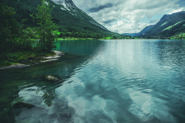 Landscape Of Norway Nature With Lake And Mountains.