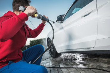 Men Cleaning His Car