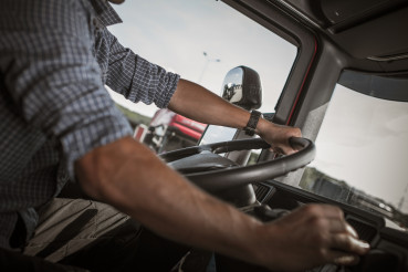 Trucker Behind the Wheel.