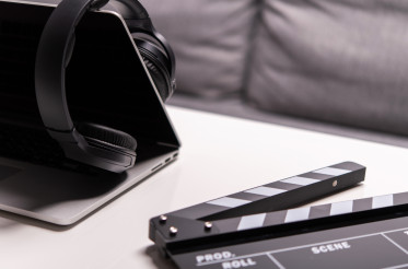 Close Up Of Computer Headphones And Clapperboard.