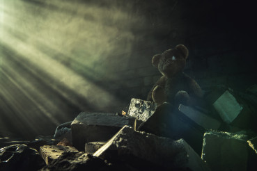 Aged Teddy Bear Inside Abandoned House Ruins Brighten Up by Sun Rays