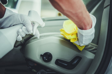 Automotive Car Detailing Worker Cleaning Vehicle Interior