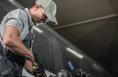 Automotive Caucasian Mechanic at Work