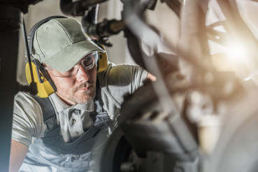 Automotive Industry Technician Looking Into Engine Compartment