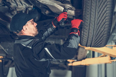 Automotive Mechanic Replacing Car Suspension Elements