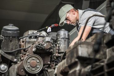 Automotive Technician Restoring Truck Engine