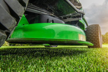 Backyard Garden Field Mowing Using Riding Tractor Grass Mower