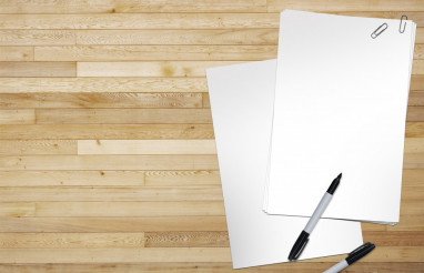 Blank Sheets of Paper on Wood