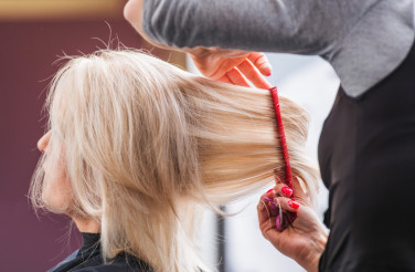 Blond Woman Hair Styling