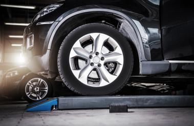 Broken Modern Vehicle in the Auto Service