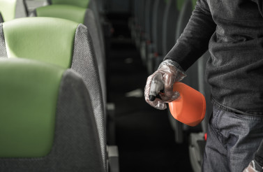 Bus Driver Cleaning and Disinfecting Seats