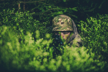 Camouflaged Poacher at Hunt