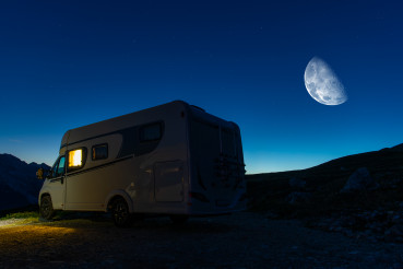 Camper Van and Clear Night Sky Over Camping Pitch