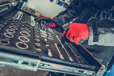 Car Mechanic Choosing Tools