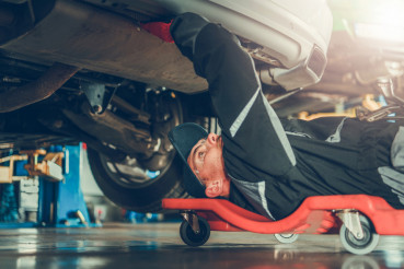 Car Mechanic Under the Car
