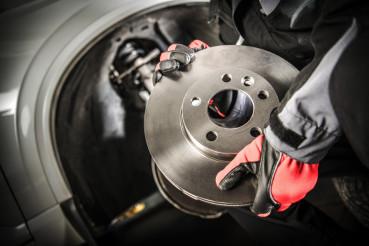 Car Mechanic with Brake Disc