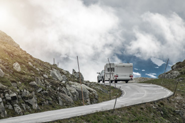 Car Pulling Travel Trailer on the Scenic Alpine Road