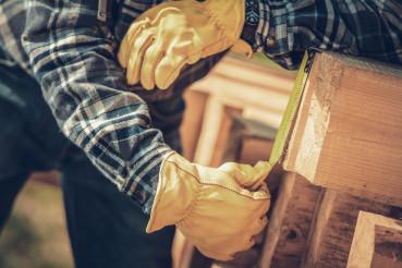 Carpenter Measuring Wood Beams Material