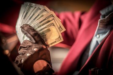 Cash Money in a Hand