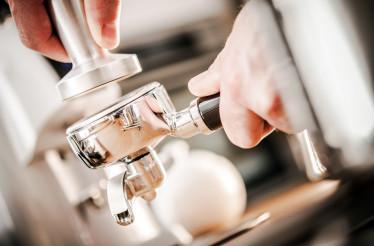 Caucasian Barista Preparing Espresso
