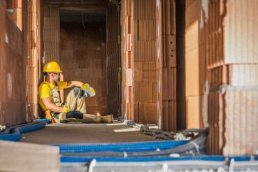 Caucasian Builder Worker Resting on the Floor