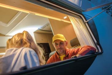 Caucasian Family Inside Camper Van