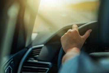 Caucasian Female Permit Driver Behind the Car Wheel