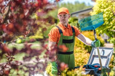 Caucasian Gardener with Rake