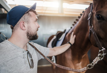Caucasian Horse Passionate and His Animal