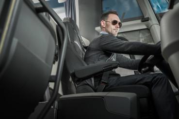 Caucasian Male Coach Bus Driver Behind Vehicle Wheel