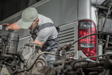 Caucasian Mechanic and the Coach Bus Diesel Engine Regeneration