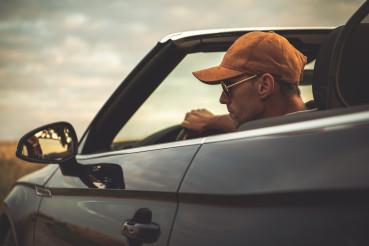 Caucasian Men Driving His Convertible Car