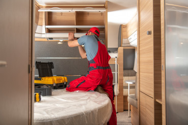 Caucasian RV Campers Technician at Work