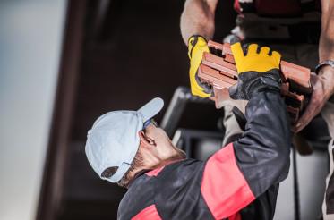Male Contractors Unloading Ceramic Roof Tile.