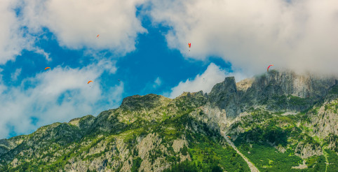 Paragliders Descending Near Mountains In Chamonix France.