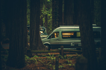 Class B Motorhome Camping Between Redwood Trees