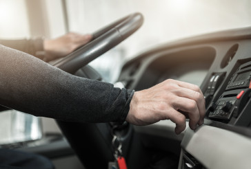 Coach Bus Driver Keeping Steering Wheel Close Up