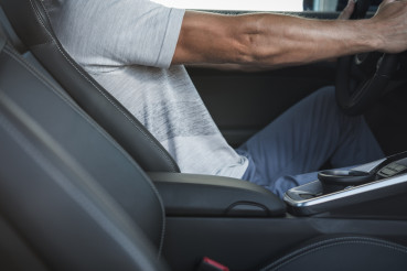 Comfortable Driver Body Position Behind Car Steering Wheel