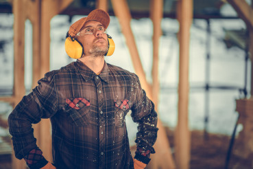 Construction Contractor Wearing Noise Reduction Headphones