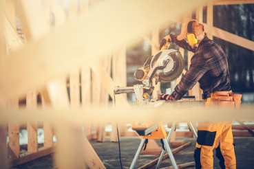 Construction Contractor Worker Using Powerful Wood Saw