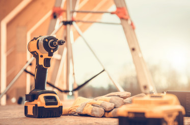 Construction Site Power Tools and Safety Gloves