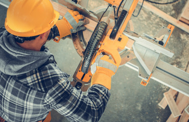 Construction Site Worker Using Powerful Circular Saw