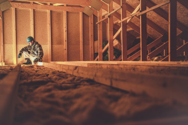 Construction Worker and the Wooden House Attic